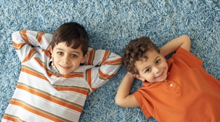 boys laying on clean carpet smiling
