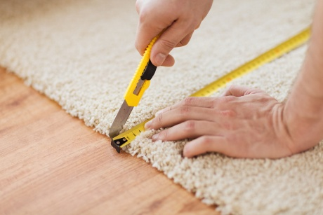 Picture of carpet measuring to repair and stretch carpet.