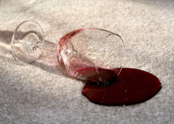 wine glass spill on carpet needs to be cleaned up using chem-dry's proprietary cleaning products